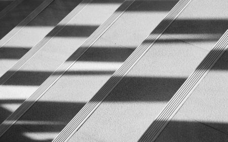 Abstract background of shadows from the window at the staircase. - monochrome 版權商用圖片