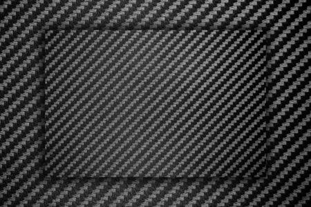 Kohlefaserverbundrohstoffhintergrund. - Platz für Werbebotschaft. Standard-Bild