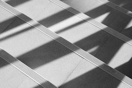 Abstract background of shadows from the window at the staircase. - monochrome Banque d'images