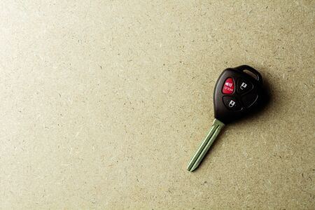 Modern electronic car keys on wooden desk. Stock Photo