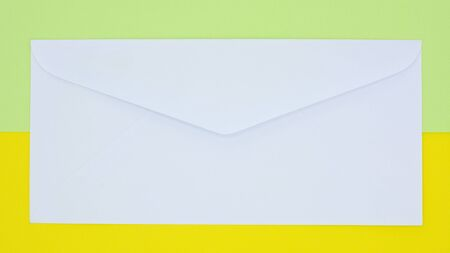 white envelope mail on yellow and green background