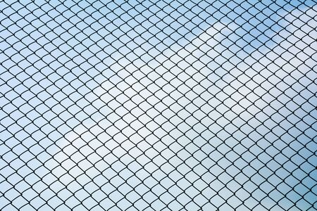 Texture the cage metal net isolate on blue sky