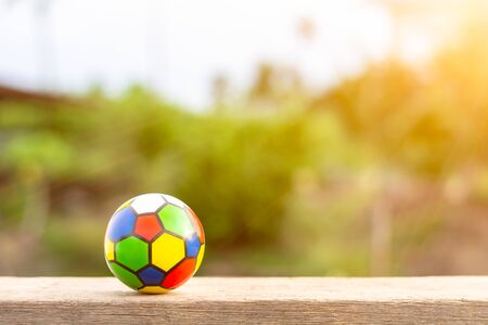 Colorful ball toy for children on wood table in the morning.