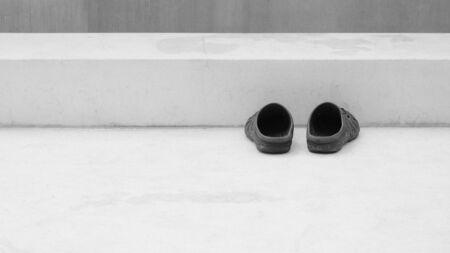 sandal at concrete staircase