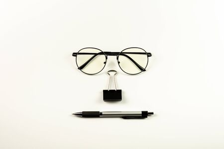 glasses, stamp paper clip and pen on white background. - office supplies and education concept. 版權商用圖片
