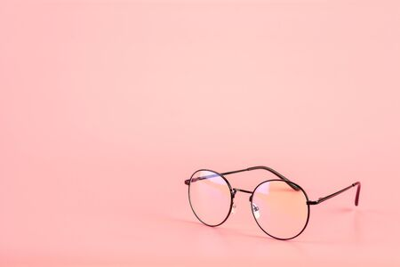 Eyeglasses on pink background. 版權商用圖片