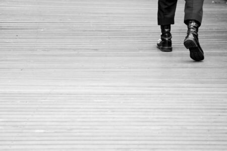 soldier walk on the wood floor - monochrome