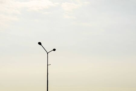 silhouette street lamp post