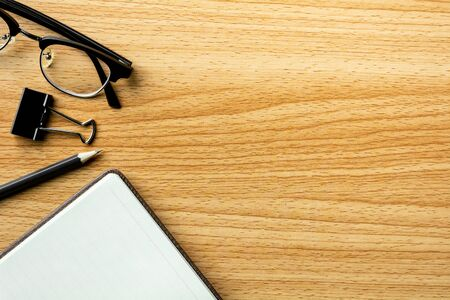 book, pencil and a glasses on wooden desk. - for creative and business concept background. 版權商用圖片