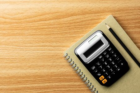 calculator and office supplies on wooden table. - Top view with copy space. 版權商用圖片