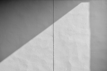 Abstract background of a white wall with shadows
