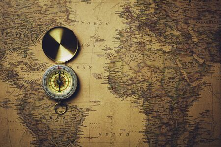Old compass on antique map. Reklamní fotografie