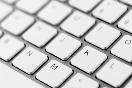 white keyboard of a modern laptop. - close up.
