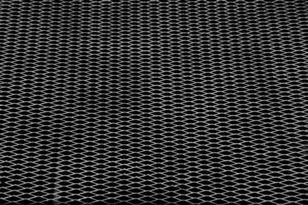 damage white steel grating on black background