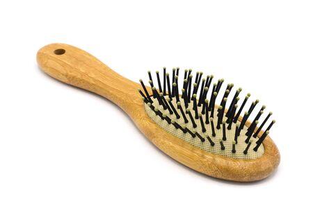 brown wooden hairbrush isolated on white background Reklamní fotografie