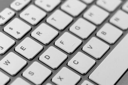 white keyboard of a modern laptop. - close up. Stock Photo