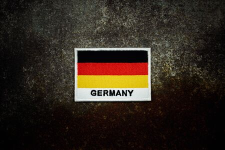 germany flag on rusty abandoned metal floor in the dark.