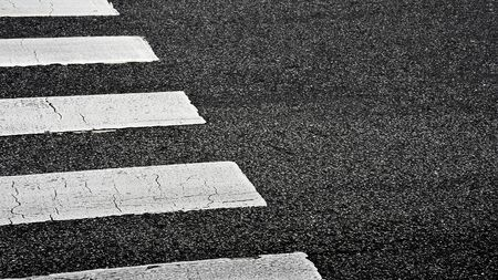 Zebra crosswalk on a asphalt road - closeup background 版權商用圖片