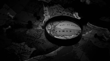 magnifying glass on the world map selective focus at yemen. - economic and business concept. Imagens