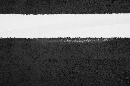 texture of asphalt road with white dashed line top view background.
