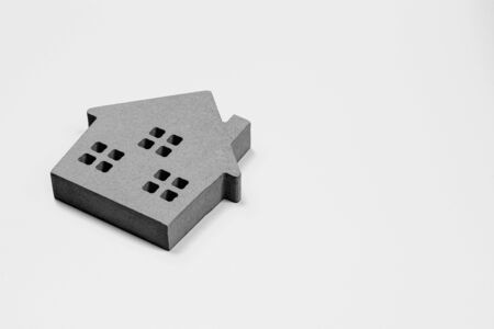 Small model of house on the desk.