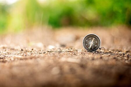 compass on the ground at abandoned area. - travel and transportation concept. Imagens
