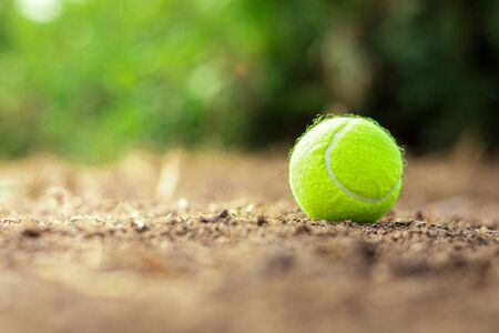 tennis ball is discarded on the ground. 版權商用圖片