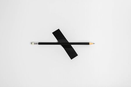 black pencil pinned with black cloth tape. Banque d'images