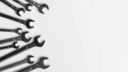 Set of spanner on white desk background. - industrial workshop hand tools concept.