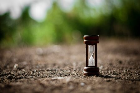 classic wood hourglass at abandoned area. - thinking and control timing ideas concept.