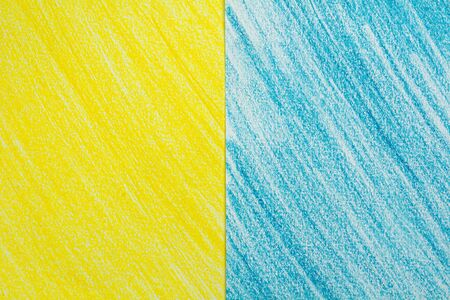Yellow and blue stroke crayon drawing sketch on white paper background.