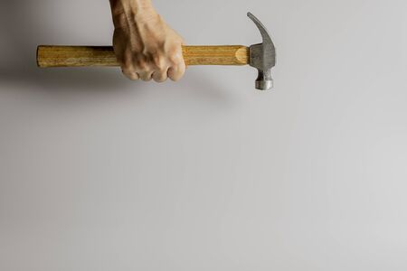 carpenter holding a hammer. - repair and construction concept.