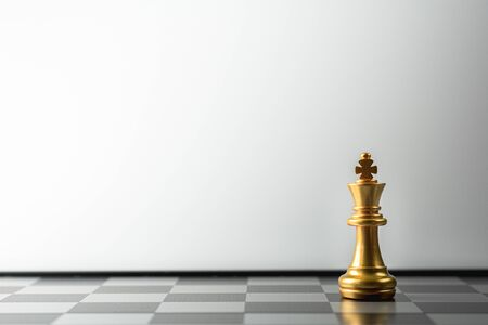 lonely golden king chess standing on chess board.