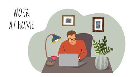 Work at home. Young man at the desk with a laptop in the interior of the room. Vertical Concept for self-isolation during quarantine