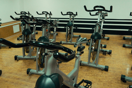 static bike: Healthy lifestyle concept. Spinning class with empty bikes. fitness, sport, training