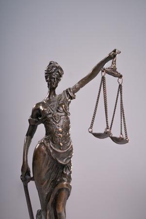 judicature: Themis on grey background. Close-up.
