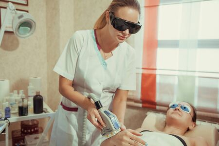 lymphatic drainage therapy: Woman on laser hair removal