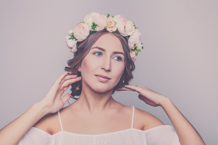 Beautiful girl in wreath of flowers Stock Photo