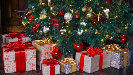 Christmas presents under the tree. New-year 版權商用圖片