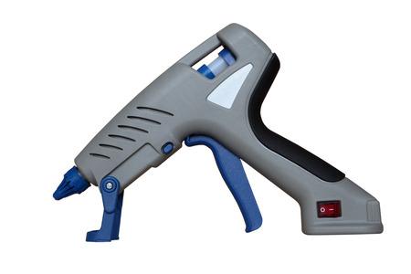 resistol: Pistola de pegamento caliente y pegamento para reparar.