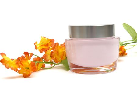beauty product: moisturizer cream and flower