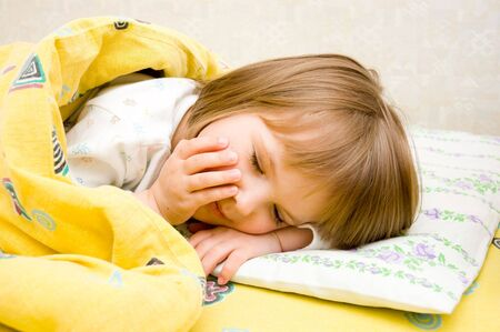 little girl is in a bed Stock Photo - 2987789