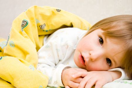 little girl is in a bed