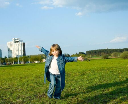 child plays on the meadow