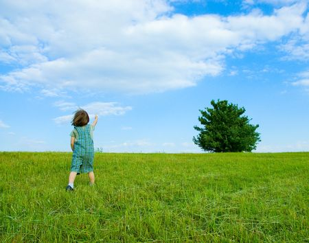 child in the meadow Stock Photo