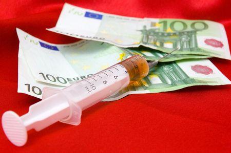 dearness: syringe and money Stock Photo