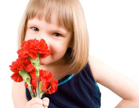 little girl with a bouquet of carnations Stock Photo - 4819651