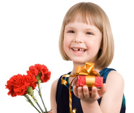 little girl with a bouquet of carnations and gift photo
