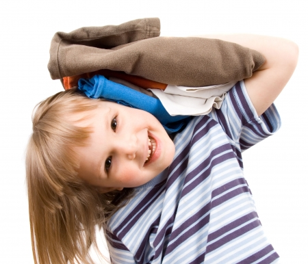 ironed: little girl with a pile of T-shirts Stock Photo