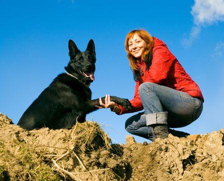 vrouw met hond  Stockfoto